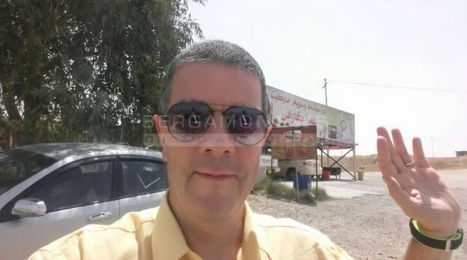 Don Luigi Ginami tra i rifugiati in Iraq
